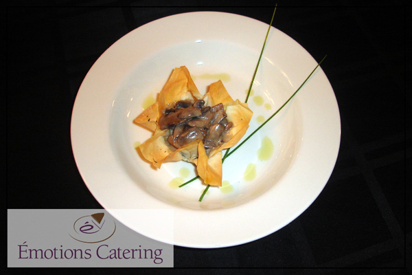 Appetizer - Mushrooms in White Wine Sauce served in a Phyllo Tulip